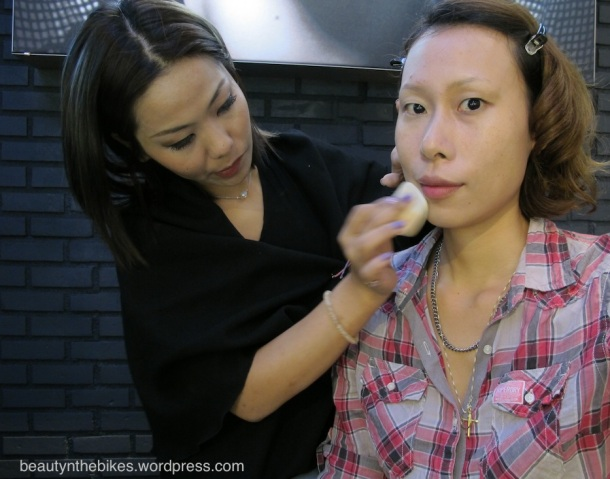 Amber applies the White Definition Powder Foundation using the dual-sided sponge